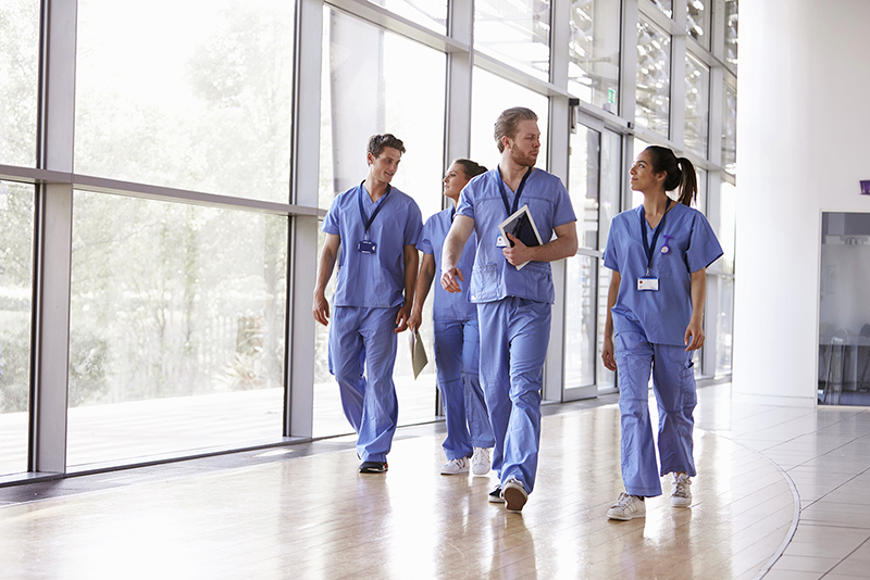 Healthcare workers walking through a hospital