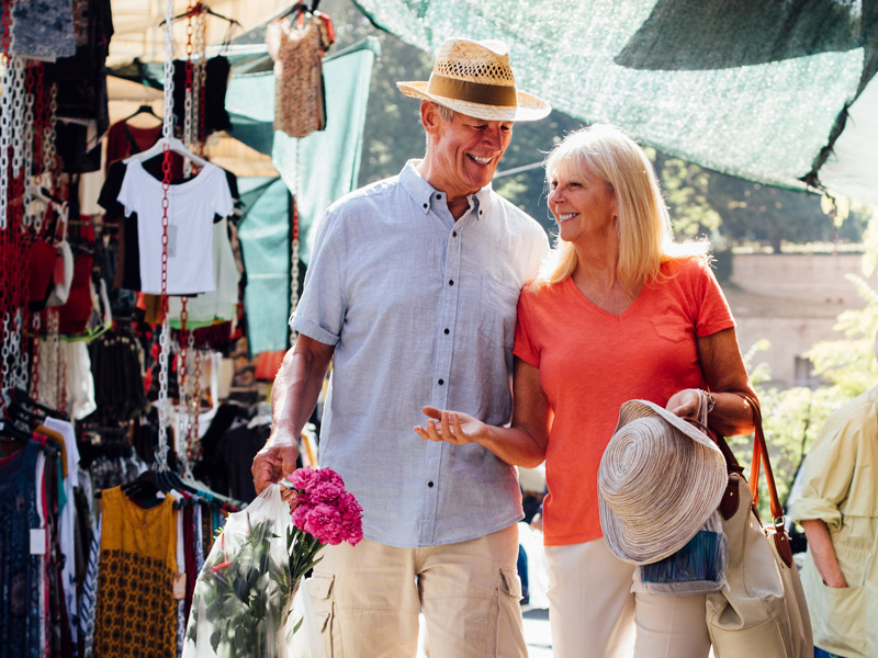 Couple walking in a outdoor market