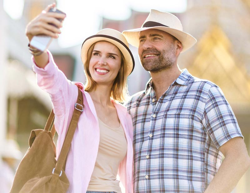 A couple taking a travel selfie